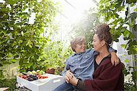 Mother and son sitting outdoors Stock Photo - Premium Royalty-Freenull, Code: 649-06943770