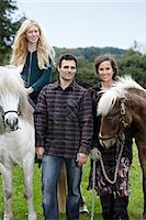 Family walking horses outdoors Stock Photo - Premium Royalty-Freenull, Code: 649-06943798