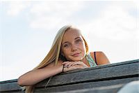 people sitting on bench - Portrait of teenage girl sitting on bench outdoors, looking at camera, Germany Stock Photo - Premium Royalty-Freenull, Code: 600-06961045