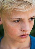 Close-up of boy outdoors, looking into the distance, Germany Stock Photo - Premium Royalty-Freenull, Code: 600-06961055