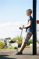 Portrait of boy outdoors with skateboard, standing on street, Germany Stock Photo - Premium Royalty-Freenull, Code: 600-06961056