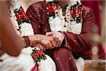 Bride and Groom holding hands during Hindu, wedding ceremony