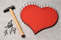restrained - Nails outlinging large, wooden heart and hammer Stock Photo - Premium Royalty-Freenull, Code: 600-06961804