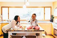 Mom and daughter in a modern kitchen, Oregon, USA Stock Photo - Premium Rights-Managednull, Code: 700-06961896