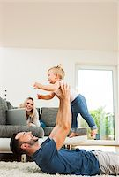Family in Living Room at Home, Mannheim, Baden-Wurttemberg, Germany Stock Photo - Premium Rights-Managednull, Code: 700-06962050