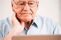 Senior Man using Laptop at Home, Mannheim, Baden-Wurttemberg, Germany Stock Photo - Premium Rights-Managednull, Code: 700-06962181