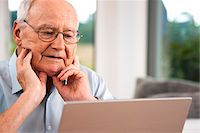 Senior Man using Laptop at Home, Mannheim, Baden-Wurttemberg, Germany Stock Photo - Premium Rights-Managednull, Code: 700-06962182