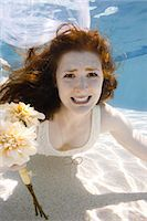 USA, Utah, Orem, Portrait of young bride with bouquet under water Stock Photo - Premium Royalty-Freenull, Code: 640-06963263