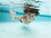 USA, Utah, Orem, Boy (4-5) swimming in swimming pool Stock Photo - Premium Royalty-Freenull, Code: 640-06963359