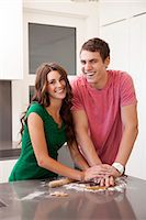 Young couple preparing gingerbread cookies Stock Photo - Premium Royalty-Freenull, Code: 640-06963389