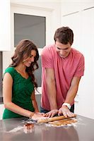 Young couple preparing gingerbread cookies Stock Photo - Premium Royalty-Freenull, Code: 640-06963391