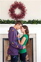 Smiling couple in room decorated for christmas Stock Photo - Premium Royalty-Freenull, Code: 640-06963404