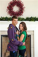 Smiling couple in room decorated for christmas Stock Photo - Premium Royalty-Freenull, Code: 640-06963406