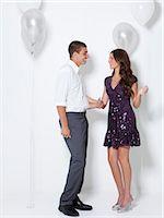 flirting - Young couple flirting at party Stock Photo - Premium Royalty-Freenull, Code: 640-06963495