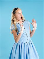 preteen open mouth - Girl (10-11) in Alice in Wonderland costume for Halloween Stock Photo - Premium Royalty-Freenull, Code: 640-06963563