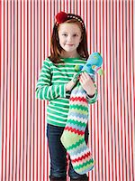 pantyhose kid - Studio portrait of girl (4-5) holding Christmas stocking Stock Photo - Premium Royalty-Freenull, Code: 640-06963699
