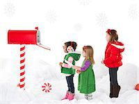 Girls (18-23months, 4-5,6-7) sending letter to Santa Stock Photo - Premium Royalty-Freenull, Code: 640-06963727