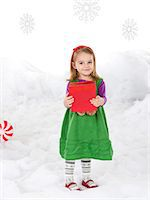 Little girl (18-23 months) holding christmas gift Stock Photo - Premium Royalty-Freenull, Code: 640-06963752
