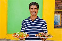 Man holding plates of mexican food Stock Photo - Premium Royalty-Freenull, Code: 673-06964604