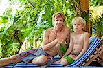 Man and boy sitting outdoors Stock Photo - Premium Royalty-Freenull, Code: 673-06964629