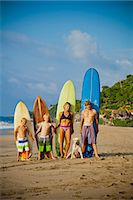 preteen bikini - Family standing on beach with surfboards Stock Photo - Premium Royalty-Freenull, Code: 673-06964632