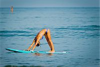fitness   mature woman - Woman in yoga pose on paddle board Stock Photo - Premium Royalty-Freenull, Code: 673-06964676