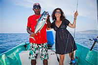 Man and woman on charter fishing boat Stock Photo - Premium Royalty-Freenull, Code: 673-06964754