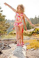 preteen bathing suit - Two children balancing on driftwood log Stock Photo - Premium Royalty-Freenull, Code: 673-06964808