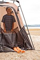 Young children playing in tent on beach Stock Photo - Premium Royalty-Freenull, Code: 673-06964825