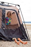 Young children playing in tent on beach Stock Photo - Premium Royalty-Freenull, Code: 673-06964827