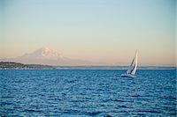 sailboat  ocean - Mt. rainier behind sail boat on puget sound Stock Photo - Premium Royalty-Freenull, Code: 673-06964834