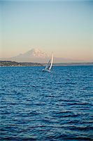 sailboat  ocean - Mt. Rainier behind sail boat on Puget Sound Stock Photo - Premium Royalty-Freenull, Code: 673-06964835