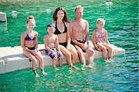 preteen swimsuit - Family sitting on dock in lake Stock Photo - Premium Royalty-Freenull, Code: 673-06964839
