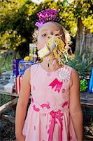 Young girl in birthday party outfit Stock Photo - Premium Royalty-Freenull, Code: 673-06964859