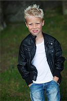 Portrait of smiling boy Stock Photo - Premium Royalty-Freenull, Code: 6102-06965579