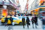 Blurred motion of cars with crowd walking on city street Stock Photo - Premium Royalty-Free, Artist: Blend Images, Code: 698-06966744