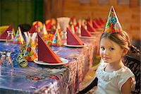 Young girl seated at her birthday table Stock Photo - Premium Royalty-Freenull, Code: 693-06967400