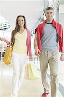 people on mall - Couple with shopping bags in mall Stock Photo - Premium Royalty-Freenull, Code: 693-06967405