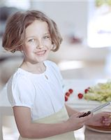 preteen girls faces photo - Young girl holding knife in kitchen Stock Photo - Premium Royalty-Freenull, Code: 693-06967468