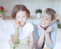 Young girl eating carrot Stock Photo - Premium Royalty-Freenull, Code: 693-06967477