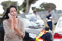 Woman crying after car accident Stock Photo - Premium Royalty-Freenull, Code: 614-06973599