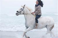Woman riding horse on beach Stock Photo - Premium Royalty-Freenull, Code: 614-06973729