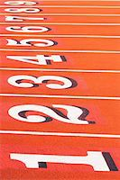 race track (people) - Numbers on running track in sportsground Stock Photo - Premium Royalty-Freenull, Code: 614-06974097