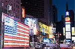 Illuminated billboards at night, New York, USA
