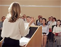 Businesswoman at podium addressing colleagues, rear view Stock Photo - Premium Royalty-Freenull, Code: 6106-06976782
