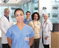 Medical professionals, portrait (focus on female doctor in foreground) Stock Photo - Premium Royalty-Freenull, Code: 6106-06977043