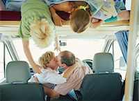 preteen kissing - Boy and girl (7-10) watching parents kissing in campervan Stock Photo - Premium Royalty-Freenull, Code: 6106-06977864