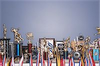Sports trophy collection on shelf Stock Photo - Premium Royalty-Freenull, Code: 6106-06978000