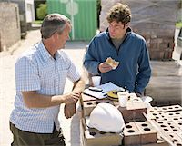 piles of work - Two builders taking break on site, smiling Stock Photo - Premium Royalty-Freenull, Code: 6106-06978551