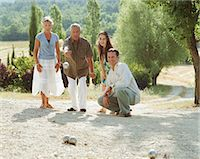 Two couples playing boule Stock Photo - Premium Royalty-Freenull, Code: 6106-06978789